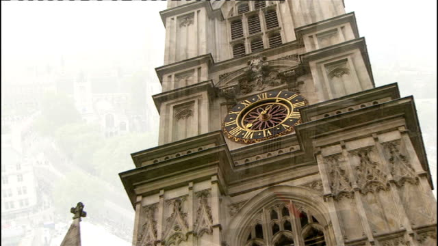 royal wedding of prince william and kate middleton itv news special ceremonial feed 0700 0800 high angle gv of westminster abbey with red carpet in... - westminster abbey stock-videos und b-roll-filmmaterial