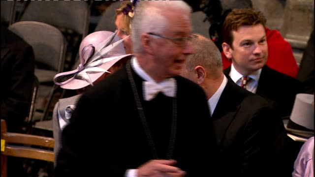 Royal wedding of Prince William and Kate Middleton ITV News Special Ceremonial Feed 0800 0900 EXT Guests arriving Royal car driven along past crowd...