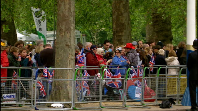 Royal wedding of Prince William and Kate Middleton ITV News Special Ceremonial Feed 0800 0900 ENGLAND London EXT Young people in crowd wearing small...
