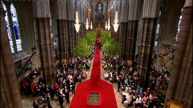 royal wedding of prince william and kate middleton itv news special ceremonial feed 0900 1000 various shots of guests taking seats and seated... - prince william stock videos & royalty-free footage