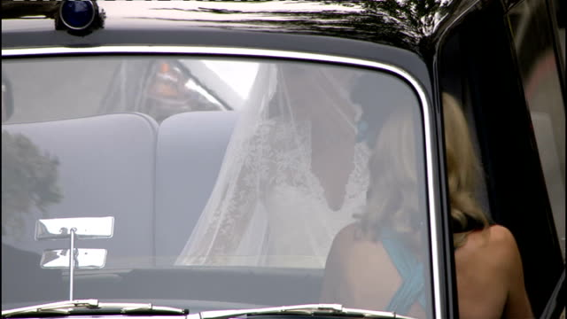 Royal wedding of Prince William and Kate Middleton ITV News Special Ceremonial Feed 1000 1100 EXT Car outside Goring Hotel Kate Middleton glimpsed as...