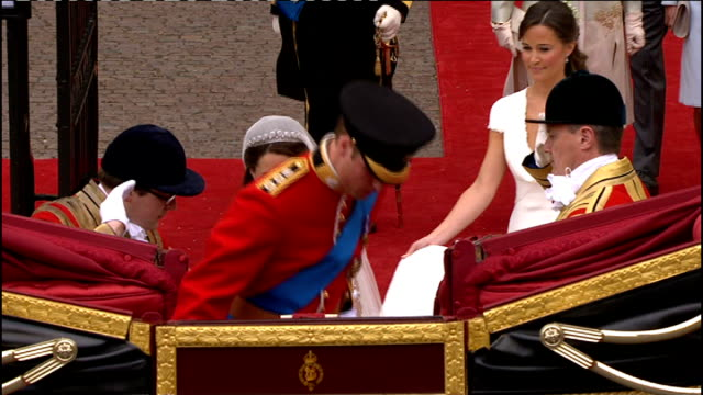 royal wedding of prince william and kate middleton itv news special pab 1130 1230 duke and duchess of cambridge walk along red carpet from abbey... - prince william stock videos & royalty-free footage