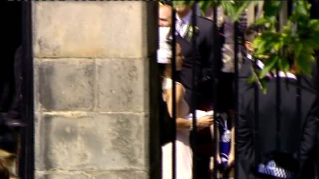 Royal wedding of Zara Phillips to Mike Tindall arrivals at church Mike Tindall out of car and waving / Tindall greeting people outside church partly...
