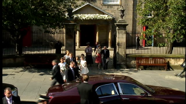 Royal wedding of Zara Phillips to Mike Tindall departures from church SCOTLAND Edinburgh Canongate Kirk EXT Long shot Zara Phillips and husband Mike...