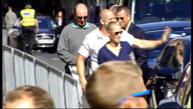 Royal wedding of Zara Phillips to Mike Tindall SCOTLAND Edinburgh EXT Zara Phillips out of car with Mike Tindall both arriving for their forthcoming...