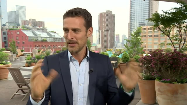 royal wedding photographer alexi lubomirski explaining how 'smarties' sweets were the magic word during the wedding of prince harry and meghan markle - media interview stock videos and b-roll footage