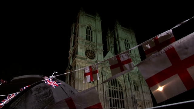 predawn dress rehearsal / kate and william rehearsal england london westminster union jack flags one with image of prince william and kate middleton... - evening gown stock videos & royalty-free footage