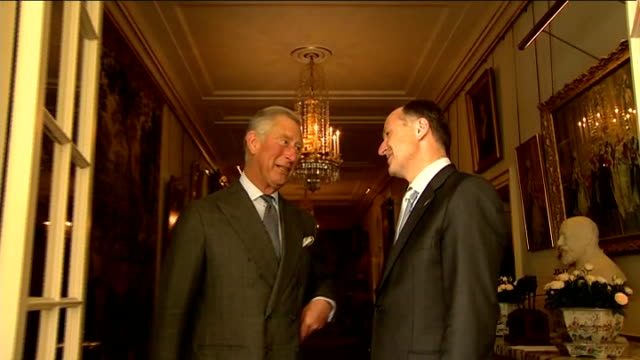 prince charles meets nz pm, john key; england: london: clarence house: ext / int car pulls up and john key gets out as enters building and shakes... - prime minister点の映像素材/bロール