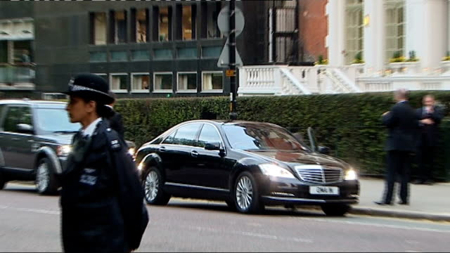 Queen hosts party at Mandarin Oriental Hotel Car arriving / Back views of Prince Andrew and daughter Princess Eugenie of York out of car then along...