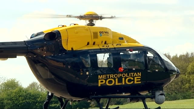 security operation general views police helicopter team essex loughton lippitts hill ext metropolitan police helicopter as rotors started / crew... - helicopter rotors stock videos and b-roll footage