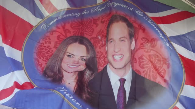 royal wedding souvenirs flags mugs tshirts postcards and dishes with pictures of prince william and kate middleton / exteriors of westminster abbey /... - souvenir stock videos and b-roll footage