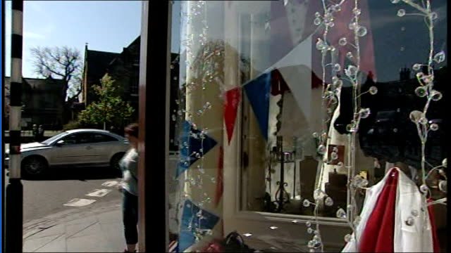 st andrews preparations exterior of 'pretty things' wedding shop / wedding dress in shop window / picture of william and kate in shop window / red... - helium stock videos & royalty-free footage