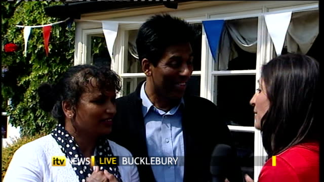 Street parties ENGLAND Berkshire Bucklebury EXT Reporter to camera Hash Shingadia interview SOT Chan Shingadia showing sari that she will be wearing...