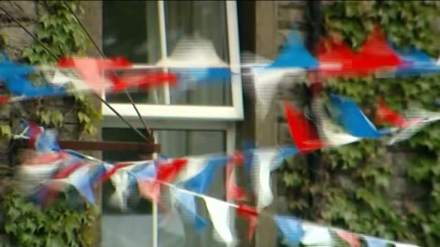 street party plans england yorkshire hebden ext village of hebden seen from above people along in village red white and blue bunting outside pub and... - street party stock videos and b-roll footage