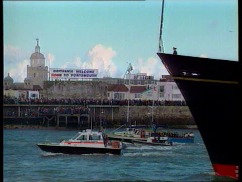 royal yacht britannia decommissioning ceremony; lib hants: portsmouth: day banner `britannia welcome home to portsmouth' pull out britannia along... - yacht stock videos & royalty-free footage