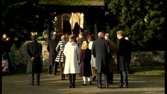 Norfolk Sandringham General views of crowds waiting /Car carrying Queen Elizabeth II arriving / Royal family along past crowds and into church /...