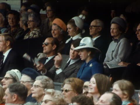 melbourne: royal box - prince charles, queen elizabeth ii and prince philip, duke of edinburh watch: man points out something to princess anne:... - australia stock videos & royalty-free footage