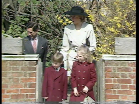 Windsor MS Queen waves as Prince Philip talks to vicar outside church PULL OUT Queen Mother Duchess of York behind them out of Church gate MS...