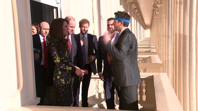 royals launch next phase of 'heads together' campaign jon salmon wearing exercise headband on balcony chatting to kate william and harry salmon kate... - will.i.am stock videos and b-roll footage