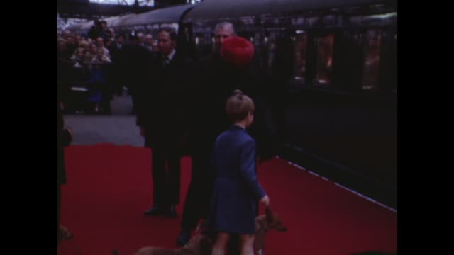 Royals leave for Sandringham ITN London Liverpool Street Station Queen Prince Edward dogs to train MS Princess Anne Queen Mother Lady Sarah dogs NS...