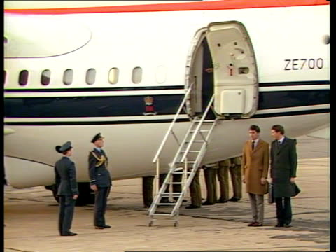 royals return from klosters following avalanche:; a) england: raf northolt: ext g/a r-l bae 146 of queen's flight landing tms pallbearers from... - prince of wales stock videos & royalty-free footage