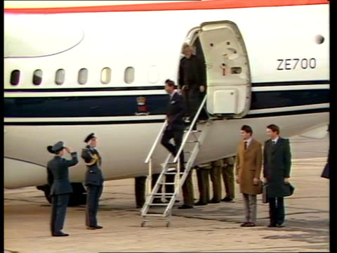 royals return from klosters following avalanche:; b) england: raf northolt: ext g/a r-l bae 146 of queen's flight landing tms pallbearers from... - ヨーク公爵夫人点の映像素材/bロール
