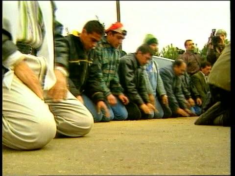 crown prince abdullah sworn in itn jordan amman ext soldiers on guard at entrance to king hussein medical centre men kneeling and praying woman... - crown prince stock videos & royalty-free footage