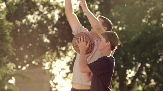Royalty Free Stock Footage of Father and son playing basketball.