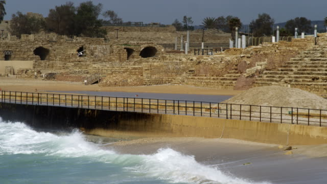 royalty free stock video footage of caesarea and waves shot in israel at 4k with red. - caesarea stock videos & royalty-free footage