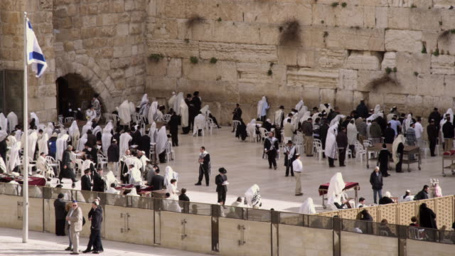 royalty free stock video footage of jews at the western wall filmed in israel at 4k with red. - gerusalemme est video stock e b–roll