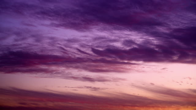 Royalty Free Stock Video Footage of purple clouds at sunset shot in Israel at 4k with Red.