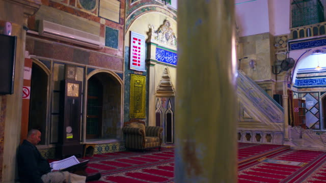 royalty free stock video footage studying in mosque filmed in israel at 4k with red. - akko stock videos and b-roll footage