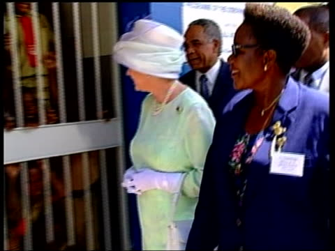 queen royal visit; uk pool jamaica: kingston: trench town: ext ziggy soul pull out meeting queen elizabeth ii queen along past school children &... - jamaica stock videos & royalty-free footage
