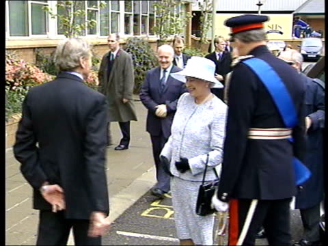 royalty: queen's golden jubilee tour: northern ireland visit; royal pool northern ireland: ext queen elizabeth ii along from car as shaking with man... - royal blue stock videos & royalty-free footage