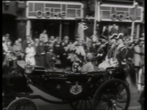 of royalty riding in carriage past crowd / holland / queen juliana? / no sound - pflanzenfressend stock-videos und b-roll-filmmaterial