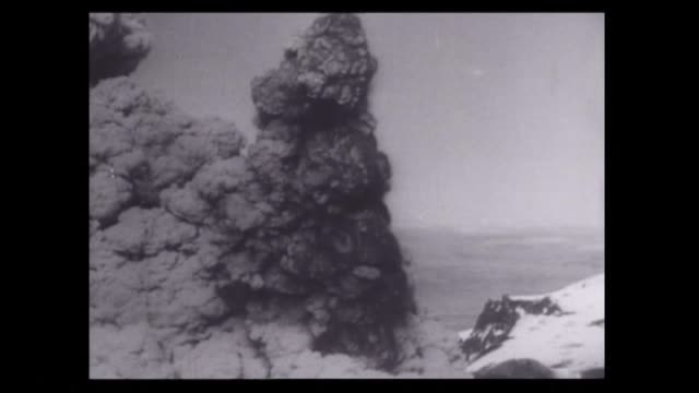 ruapehu volcano erupting for the first time in 400 years in september 1945 with explosive cloud emitting from crater and scientists at scene above... - emitting stock videos & royalty-free footage