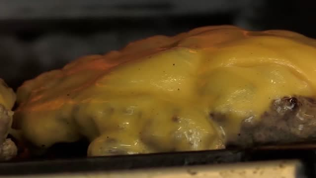 rub smokehouse in birmingham has created a giant cheeseburger 'cake' for national burger day . the cake features a victoria sponge 'bun', two huge... - cheeseburger stock videos & royalty-free footage