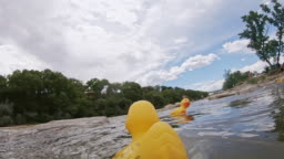 A Rubber Duck Toy with an Attached Camera Floats Down the Colorado River in Grand Junction, Colorado with Other Rubber Ducks, Falls Over, and Is Trapped Underwater