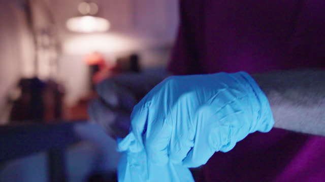 rubber gloves in creepy light - darkroom stock videos & royalty-free footage