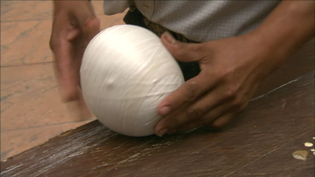 a rubber worker rolls a latex strip into a ball. - latex stock videos & royalty-free footage
