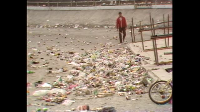 rubbish and debris littering area in front of stage following 1983 david bowie concert at western springs stadium in auckland - 1983 stock videos & royalty-free footage
