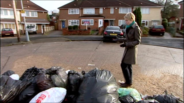 anger around the country at delays in refuse collections midlands birmingham row of semidetached houses pan mountain of rubbish bags piled in centre... - scavenging stock videos & royalty-free footage