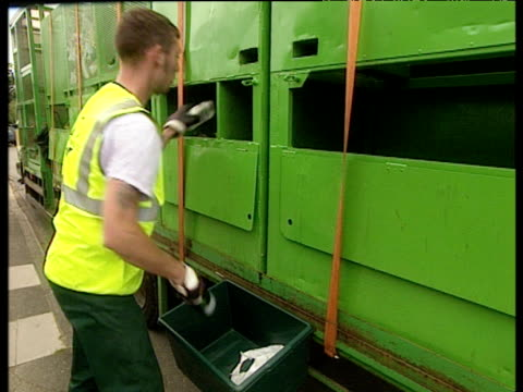 rubbish collector empties recycling box contents into different sections of collection truck - dustman stock videos & royalty-free footage
