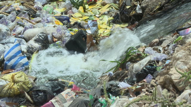 rubbish in the river nigeria is home to nearly 200 million people which has earned it the name giant of africa it is an oil rich country which has... - nigeria stock videos and b-roll footage