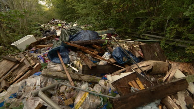 rubbish left behind by fly-tippers - environmental cleanup stock videos & royalty-free footage