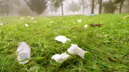 Rubbish lying scattered across a meadow