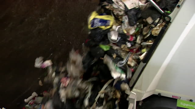 Rubbish tips out from bin lorry at waste management and recycling plant that converts rubbish to energy Bristol