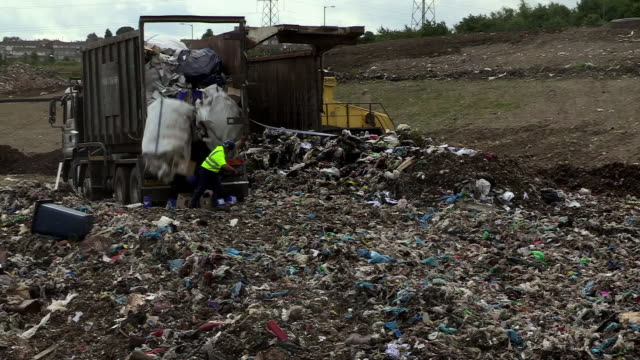 rubbish unloaded at a landfill site in the uk - landfill stock videos & royalty-free footage