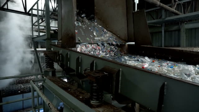 Rubbishes fed onto conveyor belt for recycling process