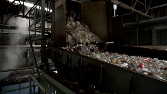 Rubbishes flown onto conveyor belt for recycling process